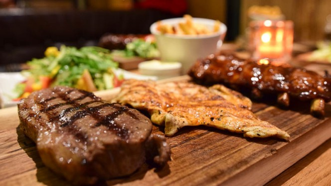 Various grilled meat cuts at The Big Apple - The Big Apple, Amsterdam